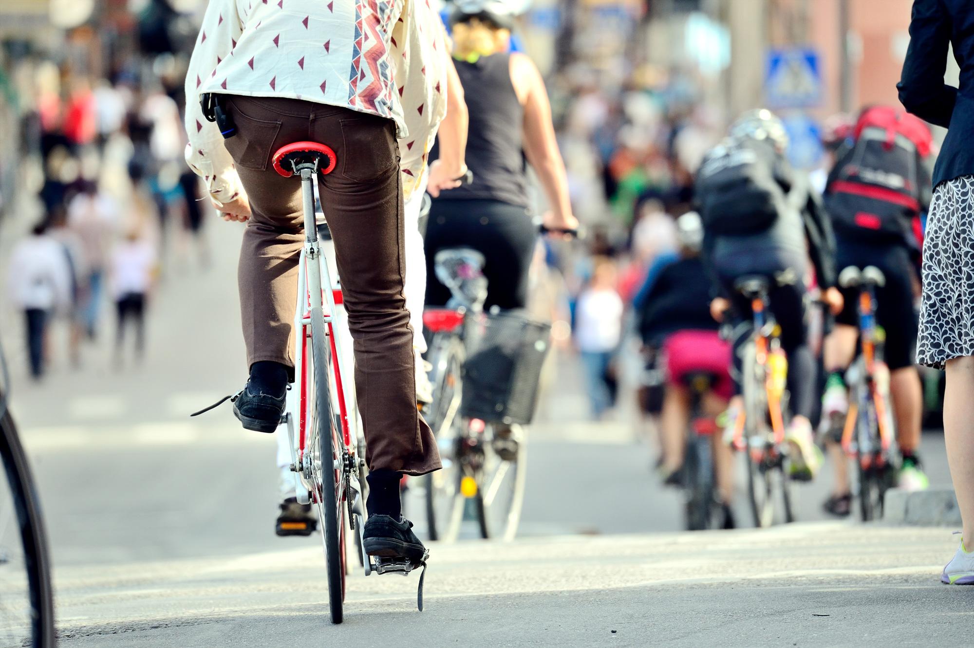 People riding bikes through city